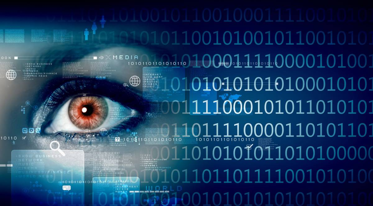 A woman's eye on a background of computer code